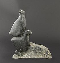 Attributed to Kellypalik Mangitak, Cape Dorset, a black stone carving of two birds atop each other