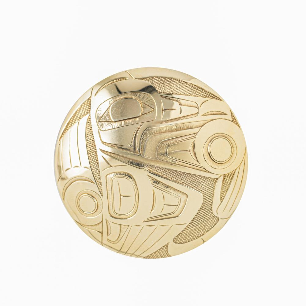 Earl Muldoe, a round 14kt yellow gold brooch/pendant, 1 7/8 in d.