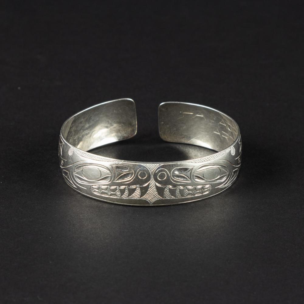 A small Art Adams sterling cuff bracelet, 5/8 in. (1.6 cm) w.