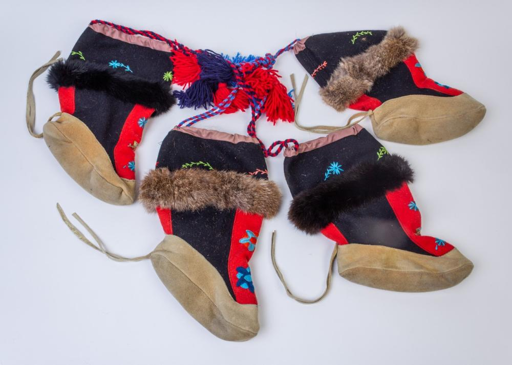 Two pairs of wool/fur and hide moccasins.