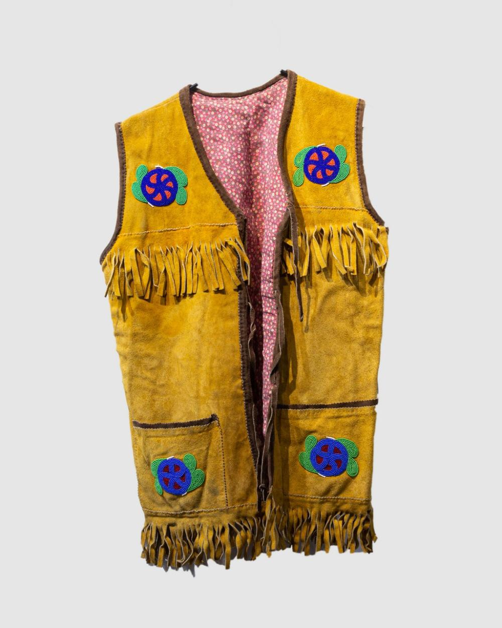 A buckskin vest decorated with bead work.