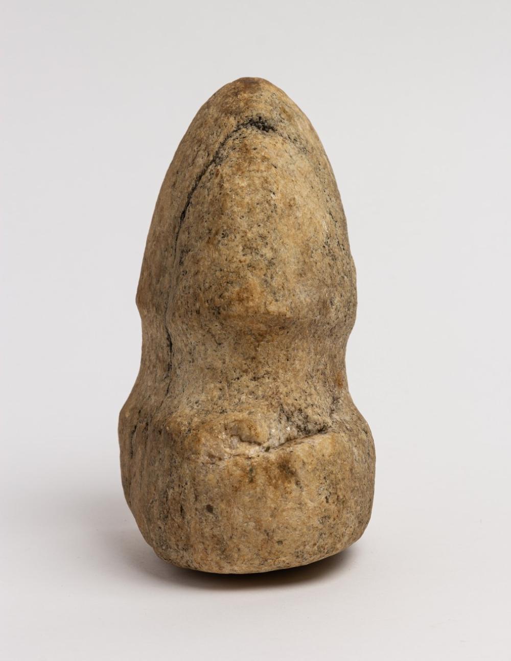 A Northwest Coast stone axe head. 4 1/4 x 6 1/4 x 3 1/4 in. (10.8 x 15.9 x 8.2 cm)