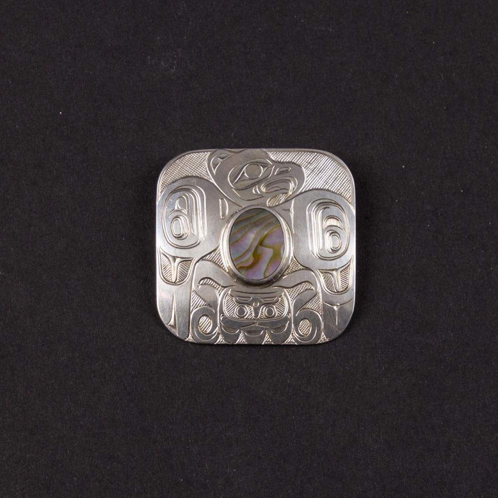 Derek Wilson, a carved silver and abalone brooch / pendant, 1 15/16 x 1 15/16 in. (4.9 x 4.9 cm)