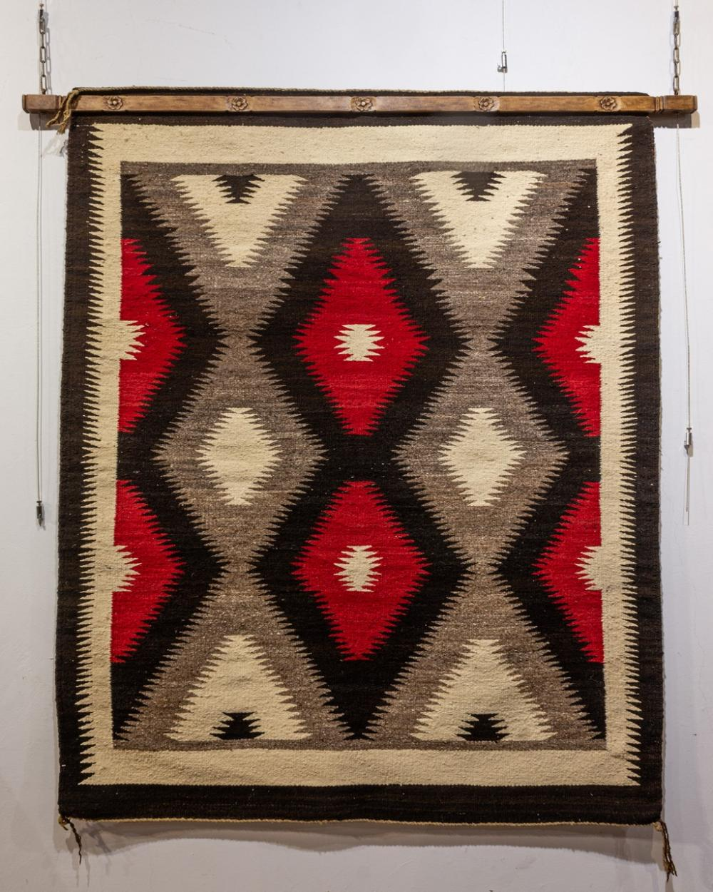 """A small Navajo hand knotted wool area rug, 3'9 1/2"""" x 4'8"""" (115.6 x 142.2 cm)"""