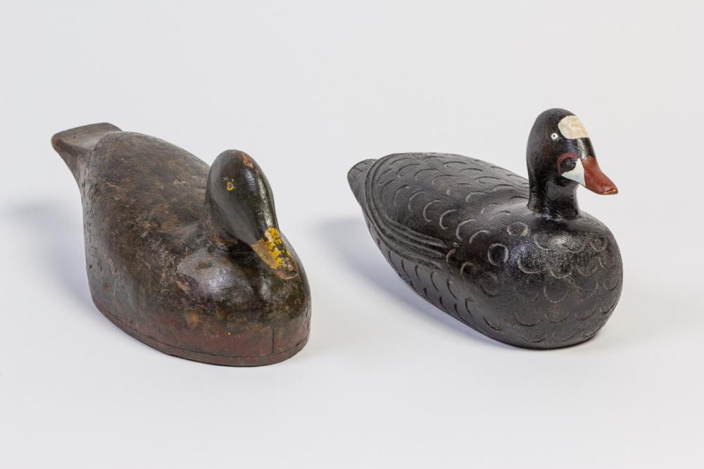 Two vintage carved and painted duck decoys, 7 1/2 in. (19.1 cm); 6 1/2 in. (16.5 cm) h.