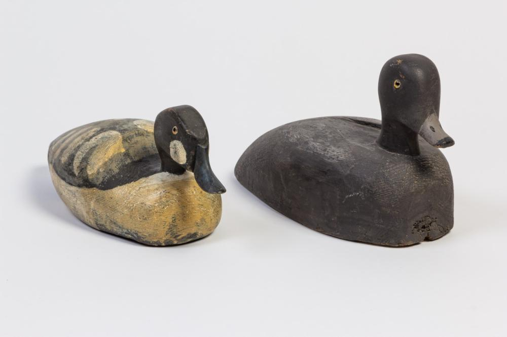 Two vintage carved wood decoys, 7 1/2 x 12 1/4 x 5 3/4 in. (19.1 x 31 x 14.6 cm); 5 1/2 x 13 1/4 x 5 1/2 in. (14 x 33.7 x 14 cm)