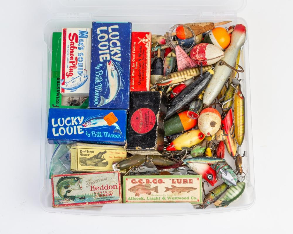 A box of assorted vintage lures.