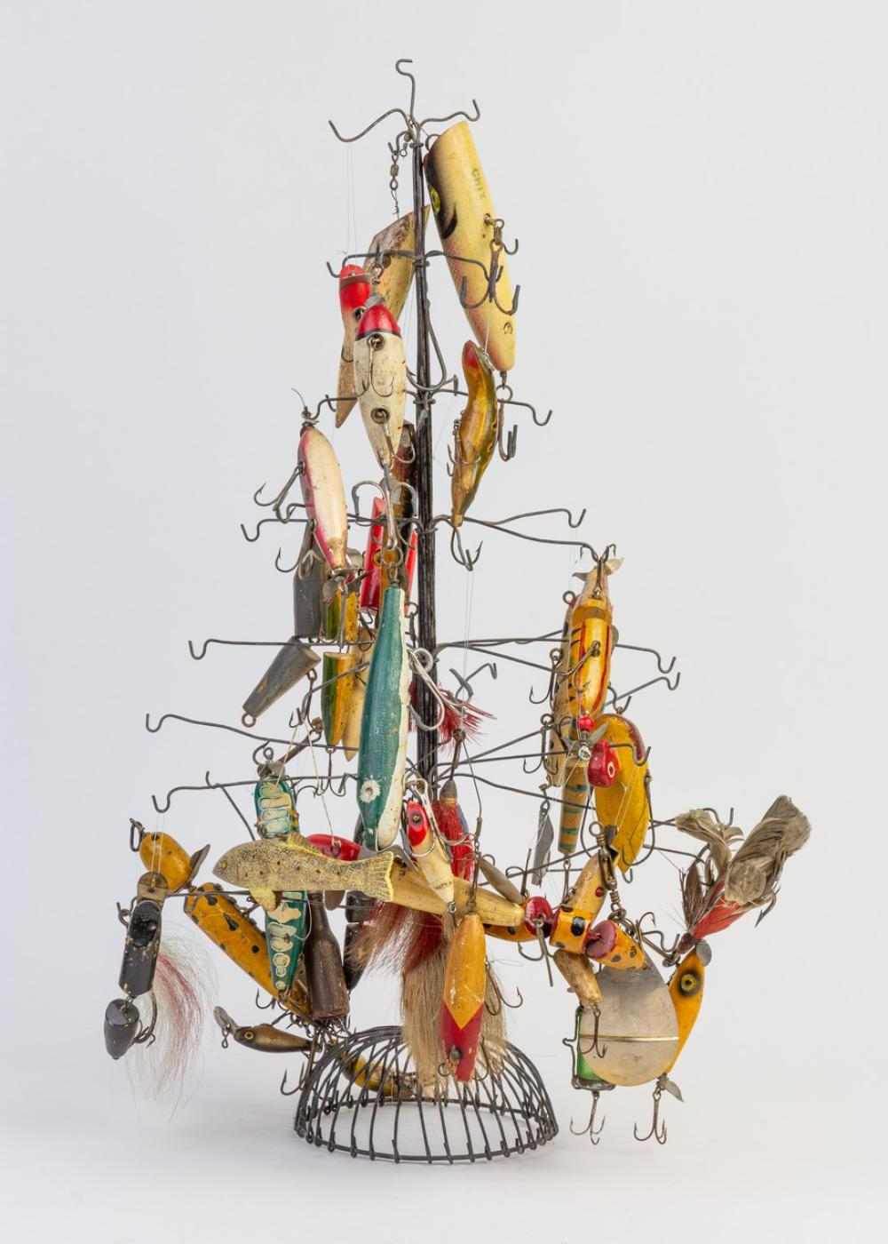 A vintage fishing lure stand together with a collection of lures.