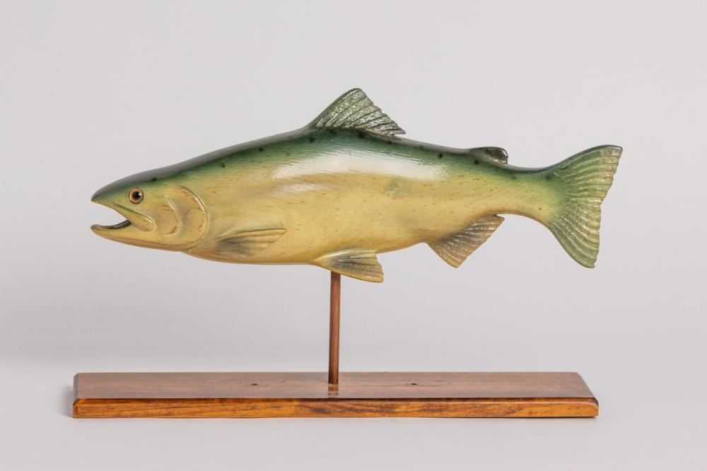 A Dale Davies carved wood model of a Kokanee salmon as a wood stand, 14 in. l. (35.6 cm)