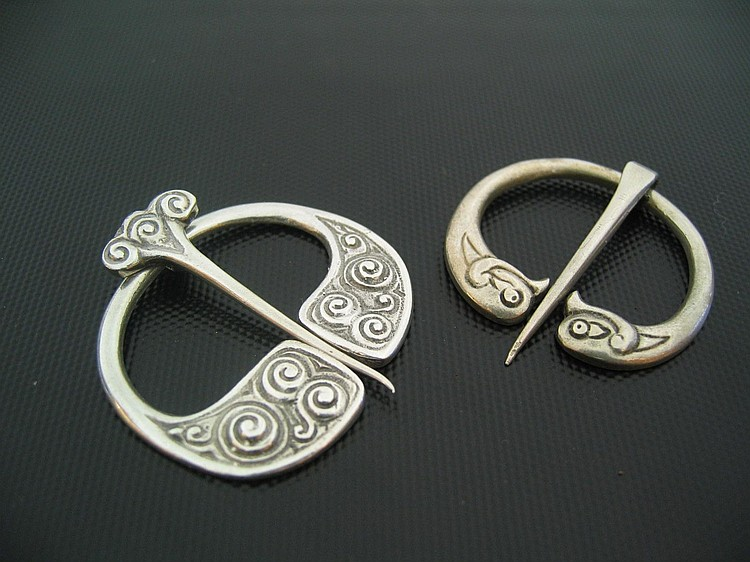 Two Iona silver penanular cape clasps by Alexander
