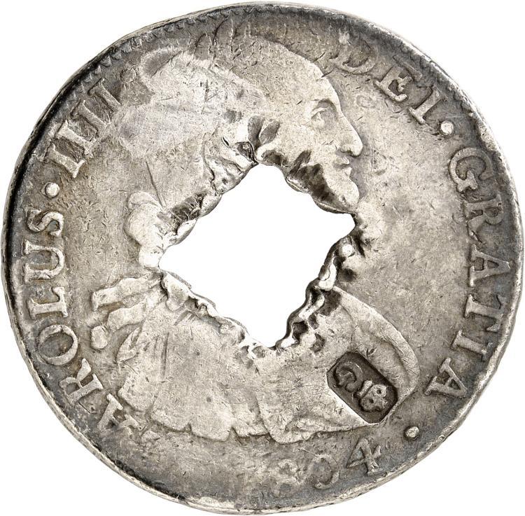 GUADELOUPE Guadeloupe, occupation anglaise (1810-1814). Contremarque de 9 livres sur un 8 reales 1804, frappé à Mexico.