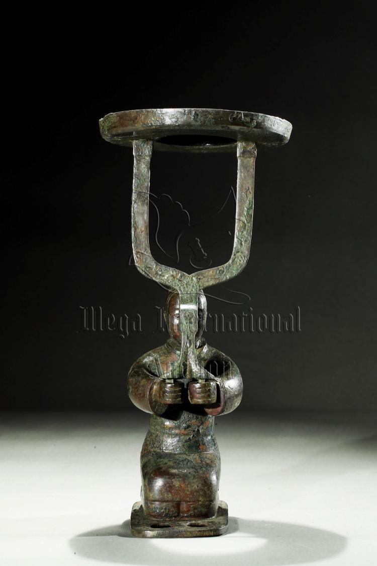 ARCHAIC BRONZE 'PERSON' LAMP