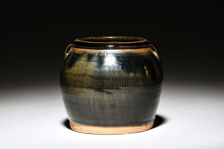 BLACK AND BROWN GLAZED JAR WITH TWO SMALL HANDLES