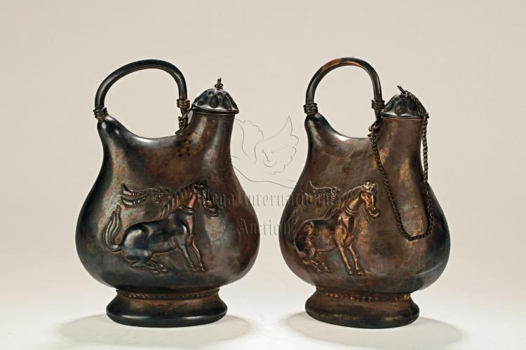 PAIR OF SILVER ALLOY CAST OIL CANISTERS