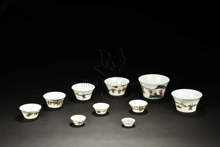 SET OF TEN FAMILLE ROSE 'CHILDREN' LAYERED CUPS