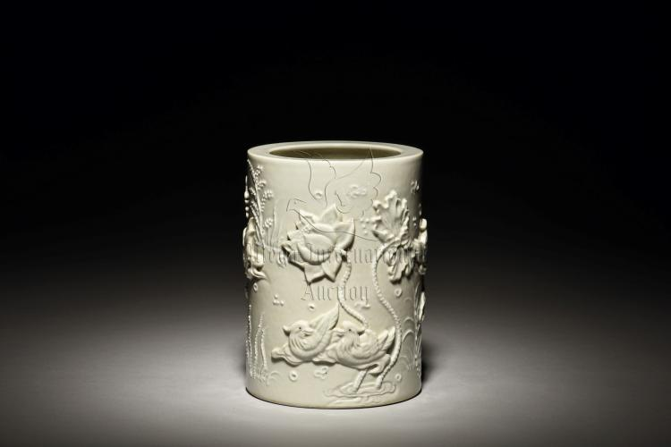 BLANC DE CHINE CARVED 'POND SCENERY' BRUSH POT