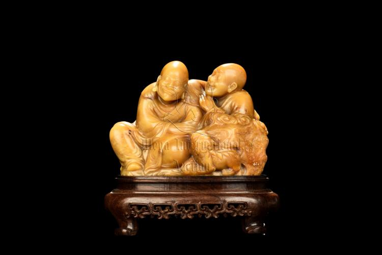 SHOUSHAN SOAPSTONE CARVED 'ARHAT' FIGURAL GROUP
