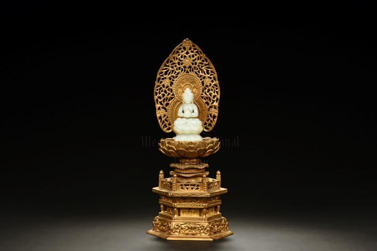 WHITE JADE CARVED SHAKYAMUNI WITH PARCEL GILT WOODEN NICHE