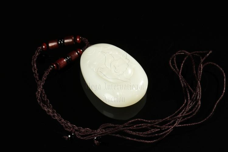 WHITE JADE CARVED GUANYIN PENDANT