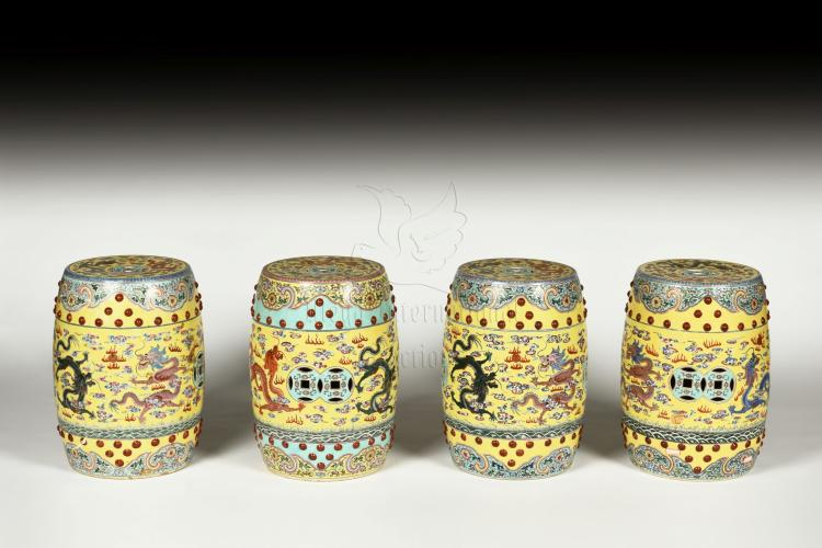 SET OF FOUR FAMILLE ROSE 'DRAGONS' GARDEN STOOLS