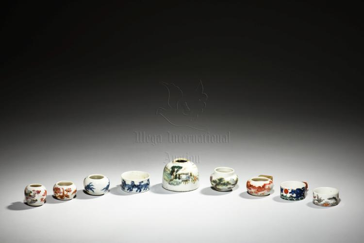GROUP OF NINE PORCELAIN BIRD FEEDERS