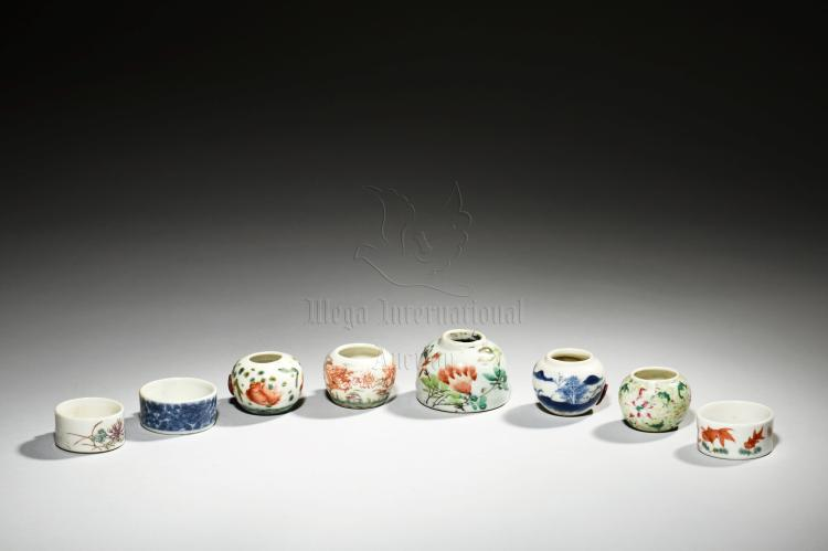 GROUP OF EIGHT PORCELAIN BIRD FEEDERS