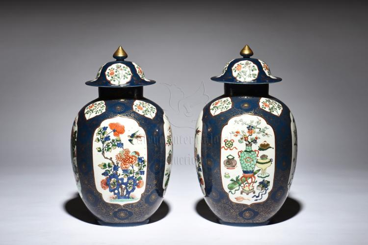 PAIR OF FAMILLE ROSE BLUE GROUND JARS WITH COVER