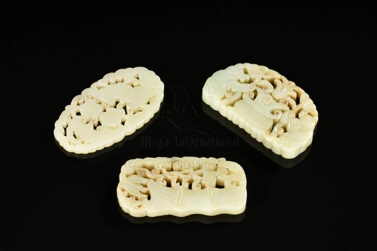 THREE PIERCE CARVED JADE PENDANTS