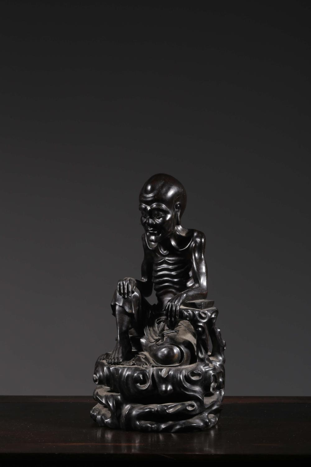 ZITAN WOOD CARVED 'RIBBED LUOHAN' SEATED FIGURE
