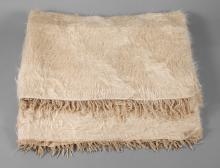Zwei Flokati-Teppiche