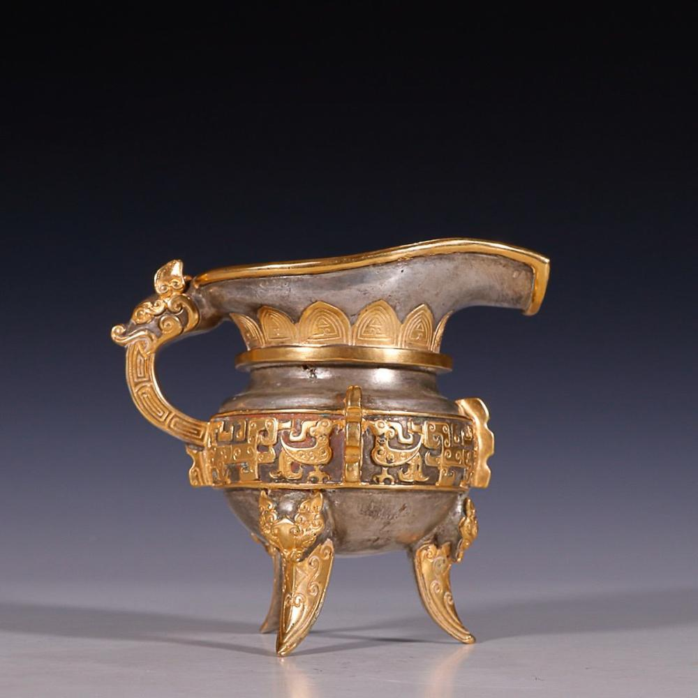SILVER-PLATED AND GILT-BRONZE HANDLED CUP