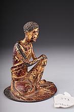 A gilt bronze figure of an emaciated Luohan,