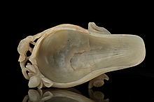 A celadon jade libation cup, Ming dynasty,