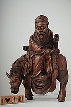 A carved wood figure of a scholar 17th/18th c.,
