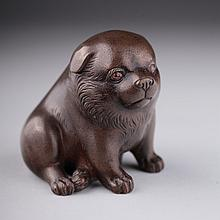 A Meiji Japanese bronze figure of a corpulent dog,