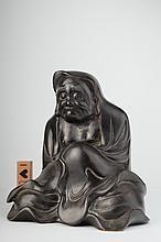 An antique bronze figure of Daruma,
