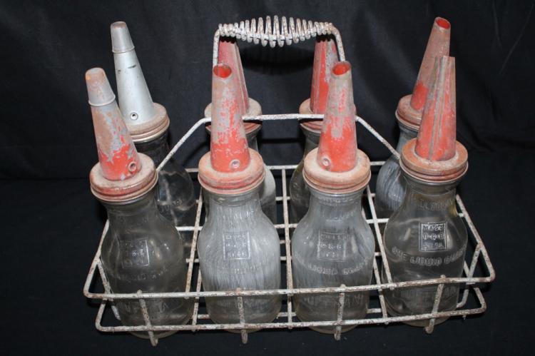 RACK OF 8 EMBOSSED HUFFMAN OIL BOTTLES