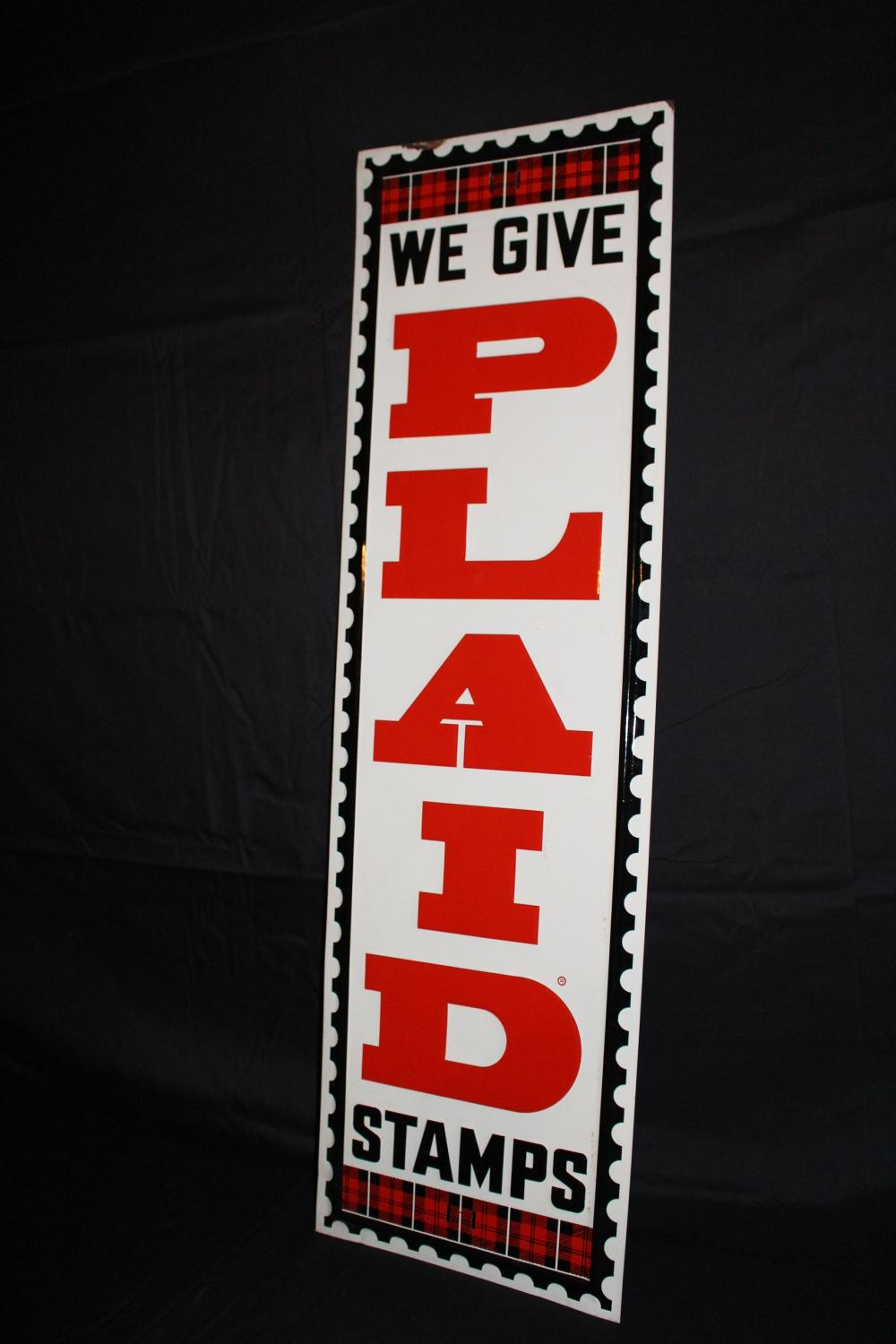 WE GIVE PLAID STAMPS TIN SIGN