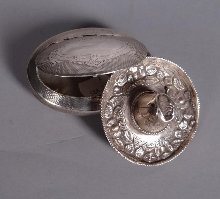 Silver oval box engraved silver. engraved silver sombrero