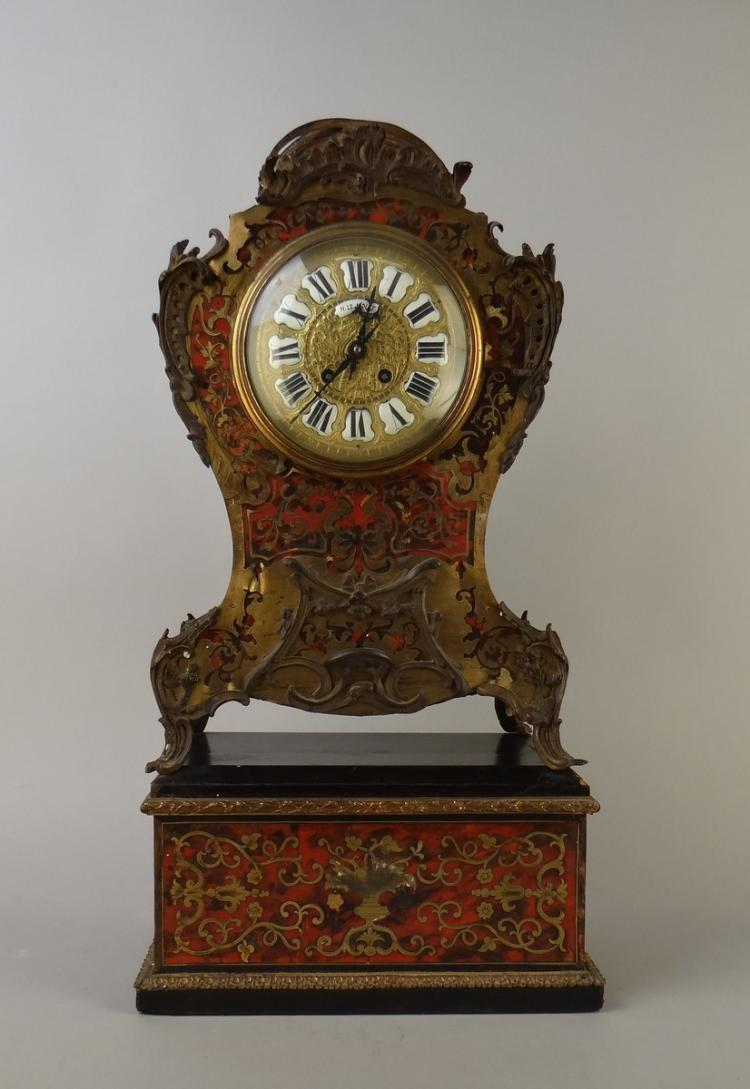Clock: Cartel in Boulle marquetry of copper / shell 18C