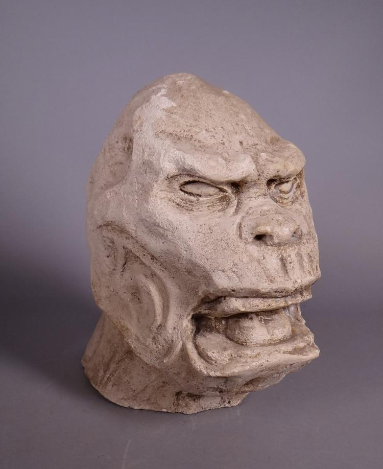 Sculpture: Engineered stone head of gorilla monogrammed at the base