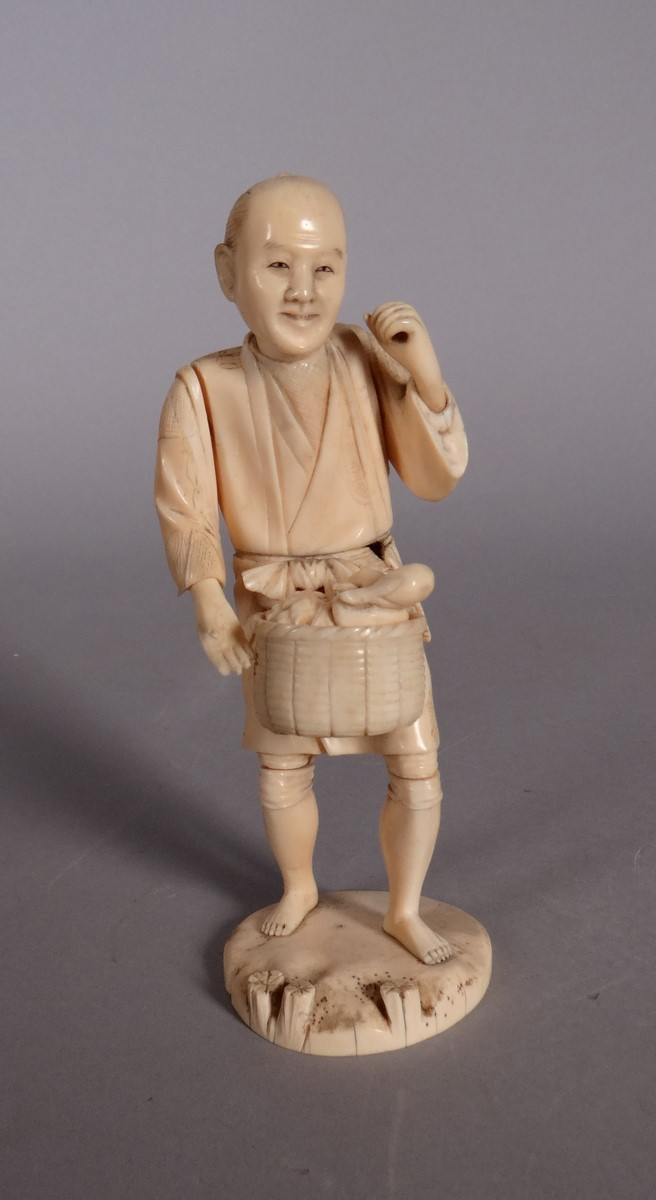 Asian: Chinese man standing in ivory  19C