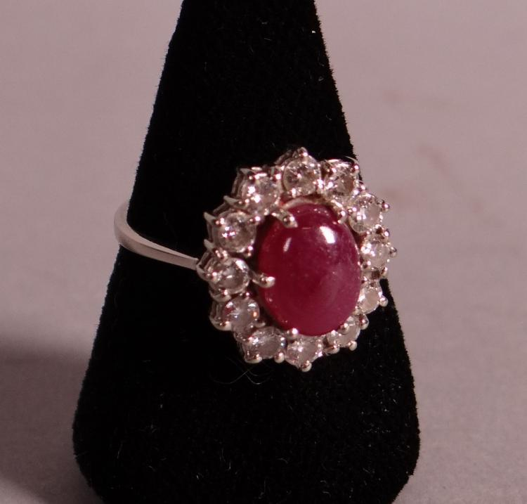 Jewelry: 18k White gold ring set with a synthetic ruby corundum entourage of 12 brilliant