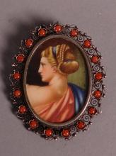 Jewel: Brooch with miniature painted on ivory entourage silver and 17 coral cabochons