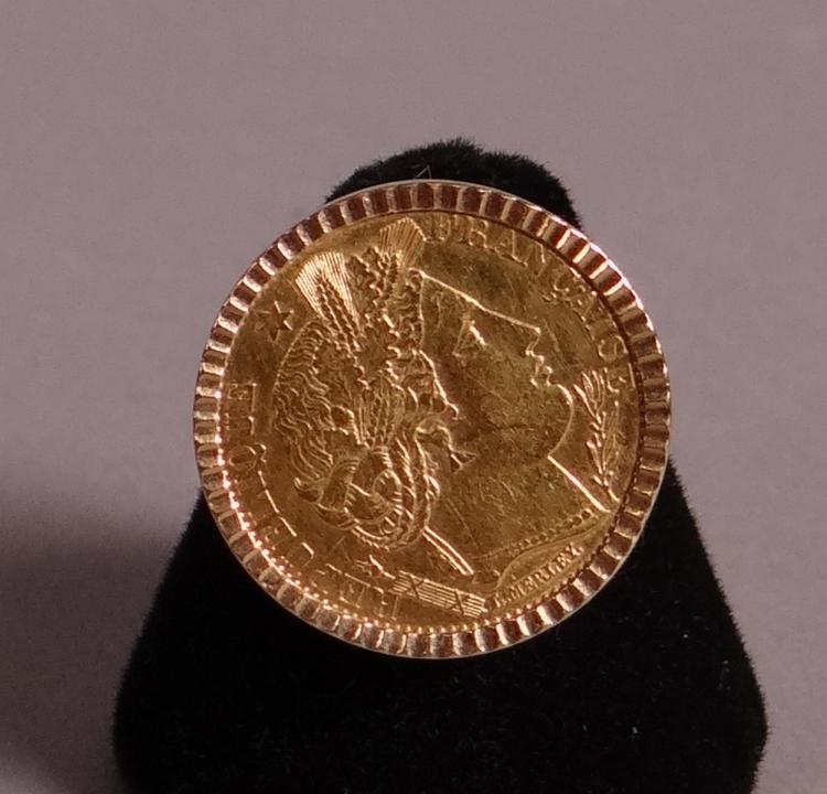 Jewelry: 18k yellow gold ring set with a coin of 10 French francs