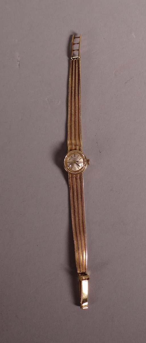 Jewelry: lady's watch TISSOT case and bracelet in 18k yellow gold