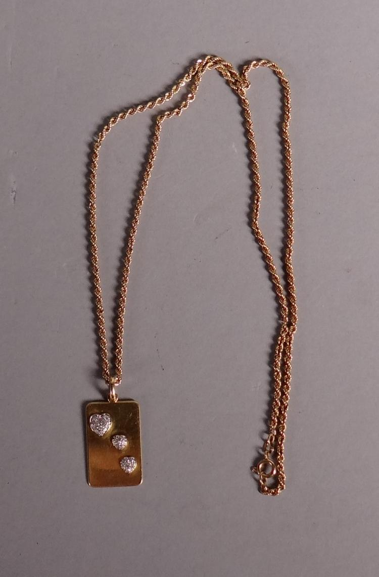 Jewelry: chain and pendant in 18K yellow gold set with 26 brilliant -3 hearts-
