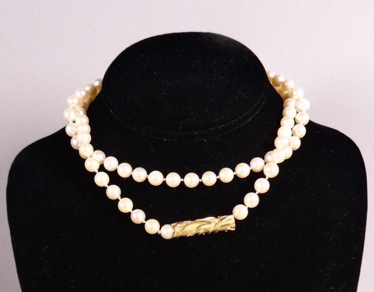 Jewelry: necklace 82 beads approx 7mm barrette worked in 18k Yellow Gold