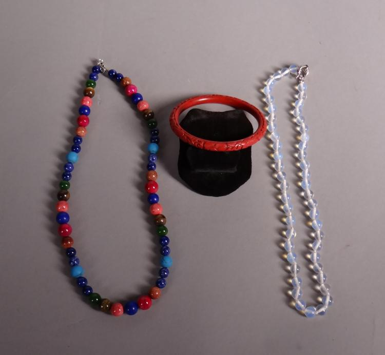 Jewel (3 pieces) necklace with moonstone beads. necklace with different stones and red lacquer bracelet