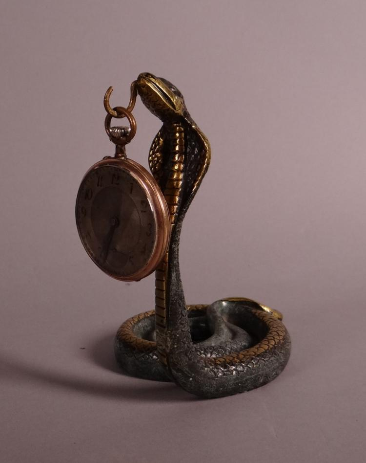Clocks: bronze watch stand with pocket watch